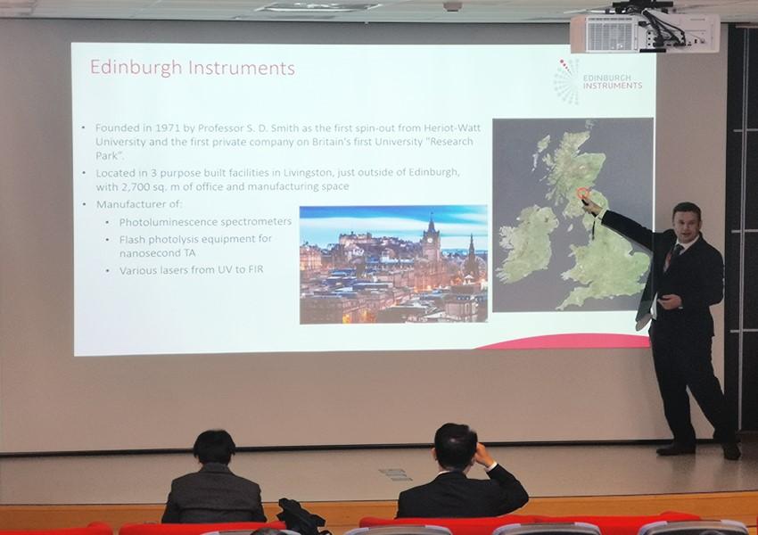Edinburgh Instruments CEO, Dr. Roger Fenske, talks to students at the APA Tudorial on Advances in Photosciences.